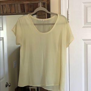 Pale yellow cap sleeve blouse
